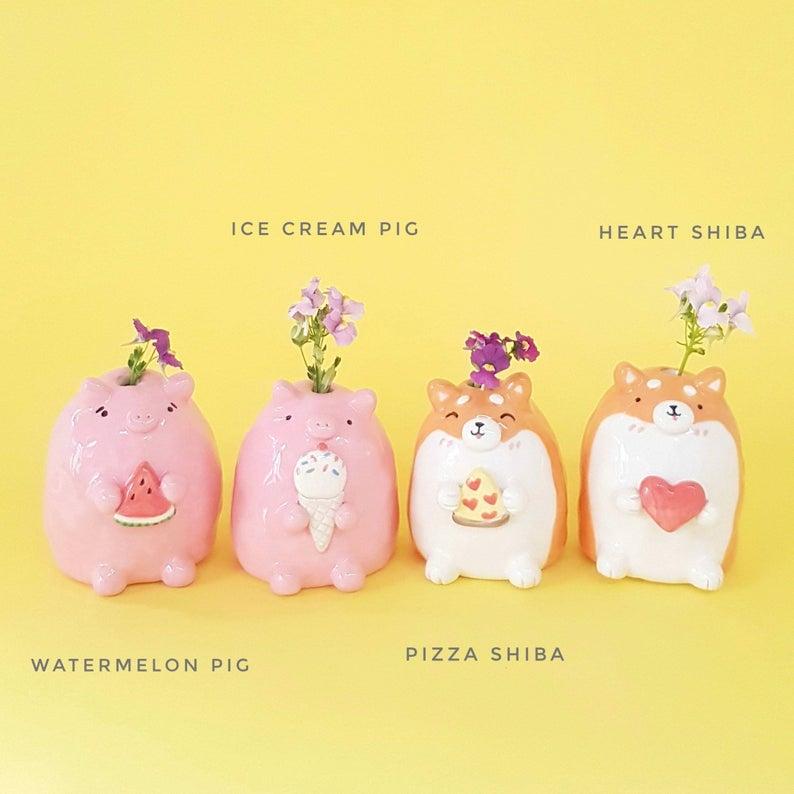 Watermelon Pig and Pizza Shiba Inu vases are handmade by Vickie Liu. Photo via Vickie Liu, Hungry Kids Club, Etsy