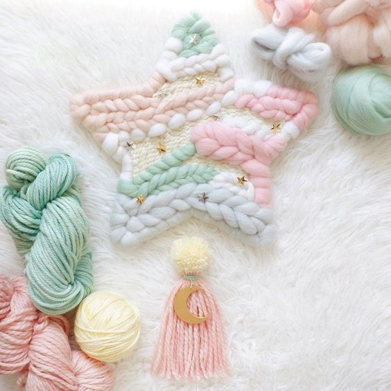 Star wall hanging with a beautiful pastel palette by @whiskerwoven via Instagram